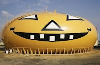 <p>The desire to turn anything and everything into a pumpkin isn't anything new. The Union Oil Company began painting their Torrance, California, petroleum storage tank to look like a pumpkin in the 1950s. Shown here nearly two decades later, it has remained a fixture in the area.</p>