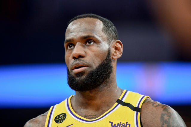 """<a class=""""link rapid-noclick-resp"""" href=""""/nba/players/3704/"""" data-ylk=""""slk:LeBron James"""">LeBron James</a> doesn't have much patience for the vile rant of a racist fan. (AP Photo/Brandon Dill)"""
