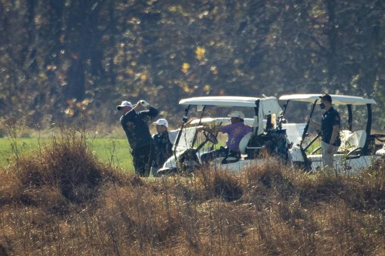 Trump plays golf at his club in Sterling, Virginia as networks project he has lost to Joe Biden