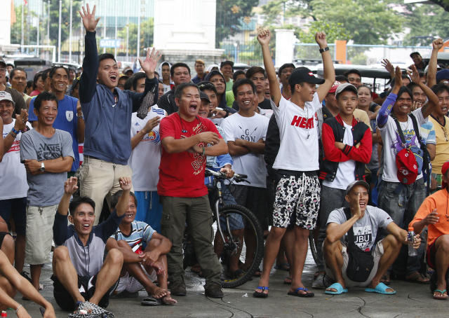 Filipinos cheer following the seventh-round technical knockout win by Philippine Senator-boxer Manny Pacquiao over Lucas Matthysse of Argentina in their WBA World Welterweight title fight in Kuala Lumpur, Malaysia Sunday, July 15, 2018 as they watch via satellite broadcast in suburban Marikina city east of Manila, Philippines. Pacquiao, 39, who clinched his 60th victory with a seventh-round knockout of Argentinian Matthysse, was his first knockout since 2009. (AP Photo/Bullit Marquez)