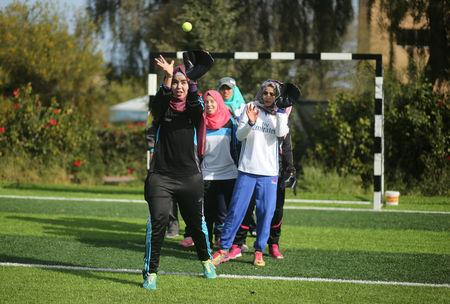 Palestinian women take part in a baseball training session in Khan Younis in the southern Gaza Strip