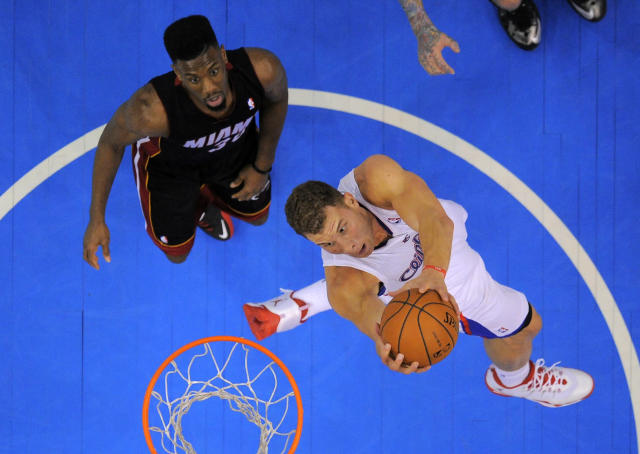 Los Angeles Clippers forward Blake Griffin, right, goes up for a dunk as Miami Heat guard Norris Cole looks on during the first half of an NBA basketball game, Wednesday, Feb. 5, 2014, in Los Angeles. (AP Photo/Mark J. Terrill)