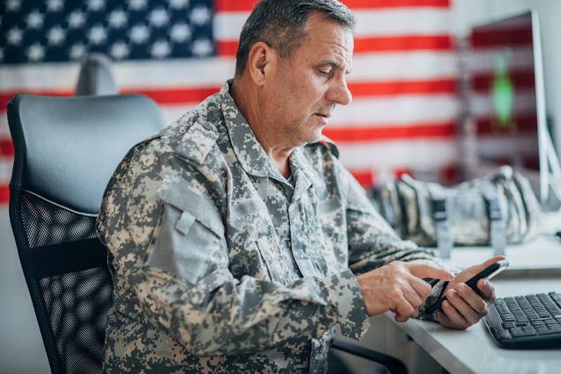 American soldier using phone in office