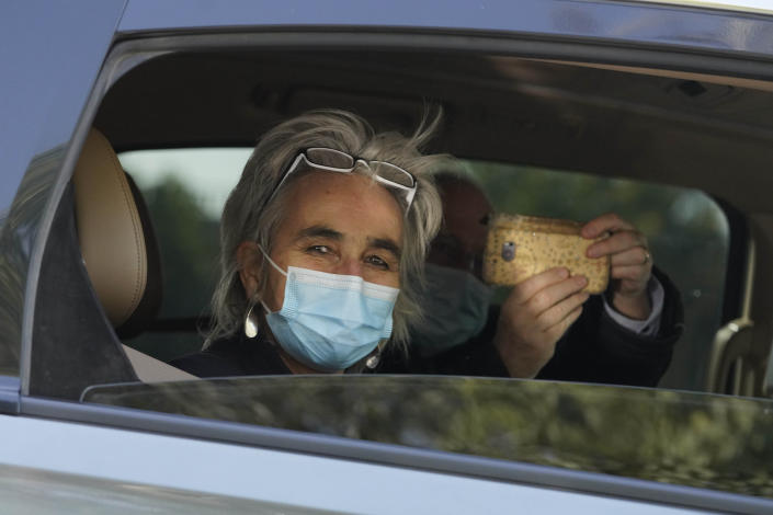 Marion Koopmans of the World Health Organization team of researchers looks out from a car during a field trip in Wuhan in central China's Hubei province on Friday, Jan. 29, 2021. The World Health Organization team of researchers emerged from their hotel Thursday for the first time since their arrival in the central Chinese city of Wuhan to start searching for clues into the origins of the COVID-19 pandemic. (AP Photo/Ng Han Guan)
