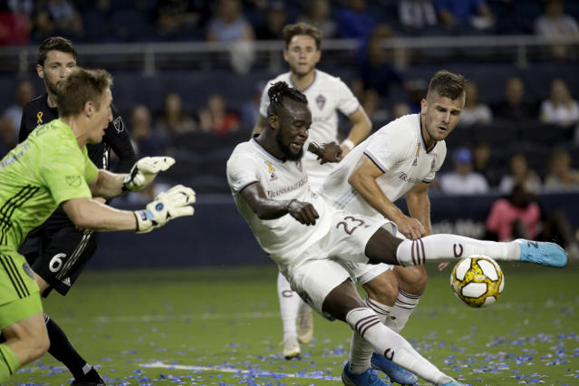 Colorado Rapids forward Kei Kamara (23) tries to score past Sporting Kansas City goalkeeper Tim Melia, left, during the first half of an MLS soccer match, Saturday, Sept. 21, 2019, in Kansas City, Kan. (AP Photo/Charlie Riedel)