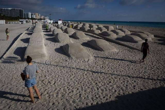 Sand cars replace sand castles at Miami art festival Art Basel