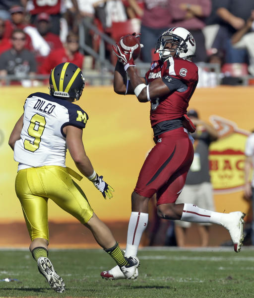 South Carolina cornerback Jimmy Legree (15) intercepts a pass intended for Michigan wide receiver Drew Dileo (9) during the first quarter of the Outback Bowl NCAA college football game, Tuesday, Jan. 1, 2013, in Tampa, Fla. (AP Photo/Chris O'Meara)
