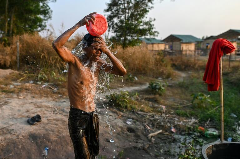 A Chin man washes in Bethel village in Hmawbi, on the outskirts of Yangon, where hundreds of members of the Chin ethnic community have settled after being displaced