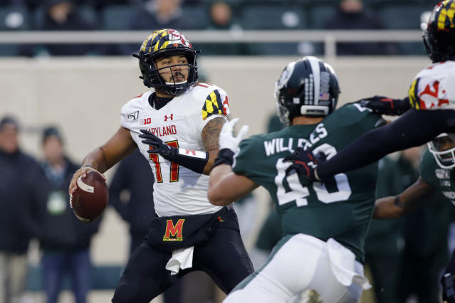 Maryland quarterback Josh Jackson, left, looks to throw against Michigan State's Kenny Willekes during the first half of an NCAA college football game, Saturday, Nov. 30, 2019, in East Lansing, Mich. (AP Photo/Al Goldis)