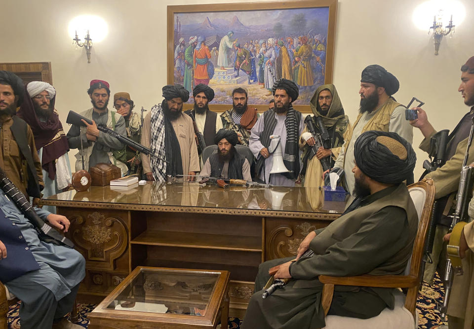 FILE - In this Aug. 15, 2021, file photo, Taliban fighters take control of the Afghan presidential palace after President Ashraf Ghani fled the country, in Kabul, Afghanistan. In the U.S. departure from Afghanistan, China has seen the realization of long-held hopes for a reduction of the influence of a geopolitical rival in what it considers its backyard. Yet, it is also deeply concerned that the very withdrawal could bring instability to that backyard - Central Asia - and possibly even spill over the border into China itself in its heavily Muslim northwestern region of Xinjiang. (AP Photo/Zabi Karimi, File)