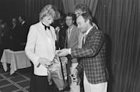 <p>The Genesis singer met Princess Diana in 1984 at a royal charity concert and wore a checkered sport coat with khaki pants. He also brought a miniature satin bomber jacket for the expectant mother.</p>