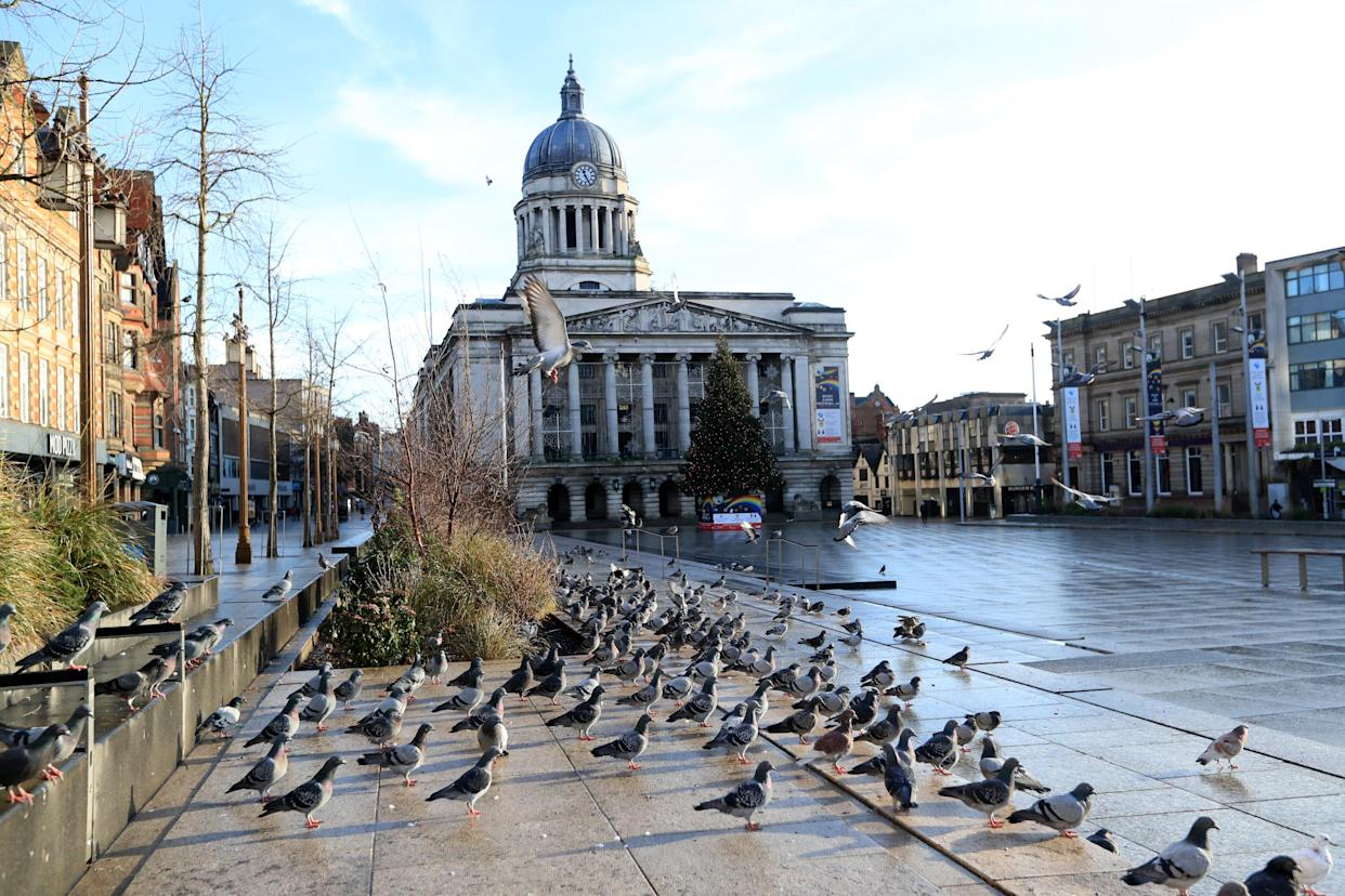 Pigeons in an empty Nottingham city centre. More than three quarters of England's population is being ordered to stay at home to stop the spread of coronavirus.