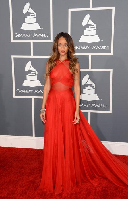 Rihanna (without boyfriend Chris Brown) takes sheer to a whole new level in a sexy red gown. Showing off her flowing, long locks, the Barbadian beauty makes sure all eyes are on her.  (Photo by Jason Merritt/Getty Images)