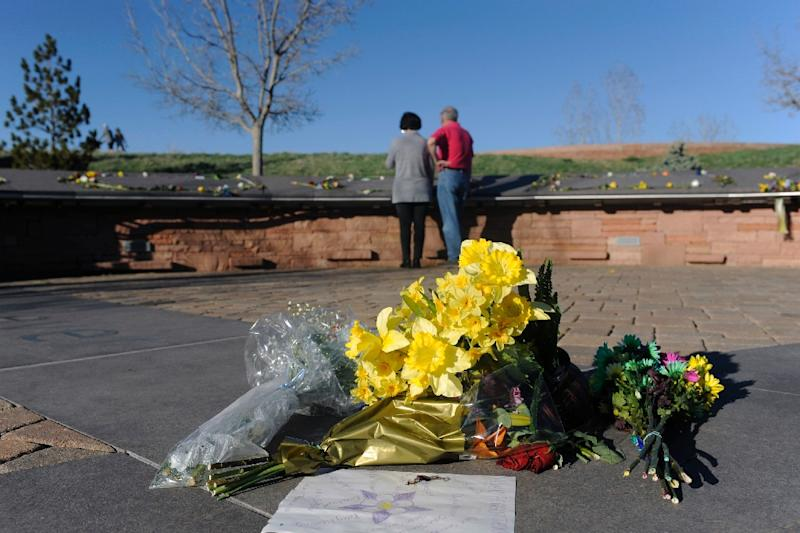 Flowers lie at the center of the Columbine Memorial at Clement Park in Littleton, Colorado, before a community vigil for the 20th anniversary of the Columbine High School massacre (AFP Photo/Jason Connolly)