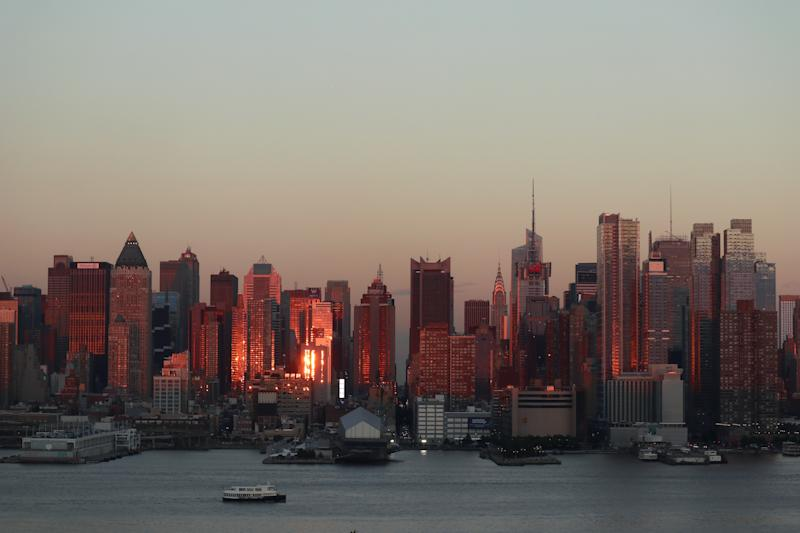 The sun sets on midtown Manhattan and the Chrysler Building on the summer solstice in New York City on June 21, 2017 as seen from Weehawken, NJ.