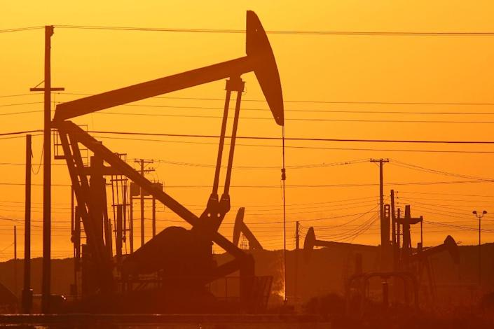 The benchmark Brent crude contract lost ground Tuesday, slipping to $49.65 in early afternoon European business while US's WTI contract eased to $48.19 (AFP Photo/David Mcnew)