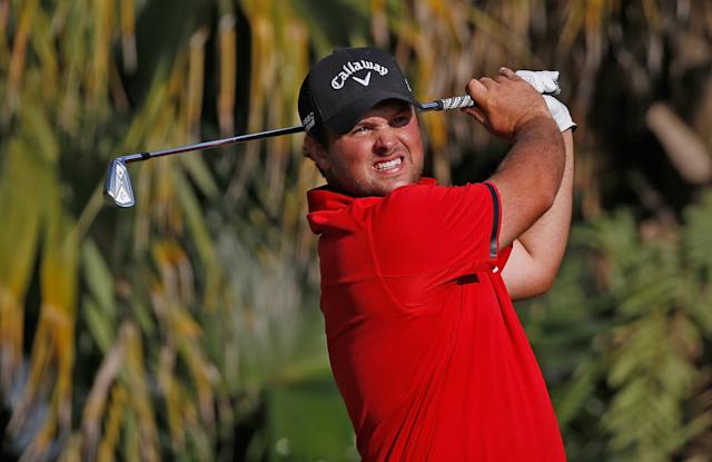 DORAL, FL - MARCH 09: Patrick Reed hits his tee shot on the 13th hole during the final round of the World Golf Championships-Cadillac Championship at Trump National Doral on March 9, 2014 in Doral, Florida. (Photo by Chris Trotman/Getty Images)