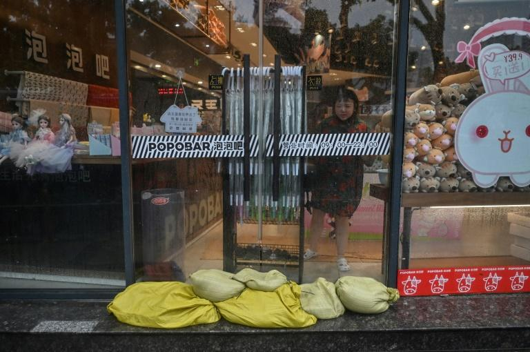 Residents of Ningbo have been preparing for the coming typhoon, which is already bringing strong gusts and rain