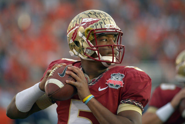 Florida State quarterback Jameis Winston (5) warms up before the NCAA BCS National Championship college football game against Auburn, Monday, Jan. 6, 2014, in Pasadena, Calif. (AP Photo/Mark J. Terrill)