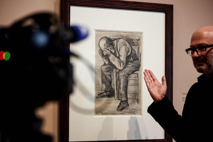 """A man gives explanations in front of a newly discovered work by Vincent van Gogh """"Study for """"Worn out"""" from 1882, displayed at the Van Gogh Museum's in Amsterdam on September 16, 2021."""