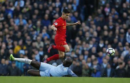 Liverpool's Philippe Coutinho in action with Manchester City's Yaya Toure