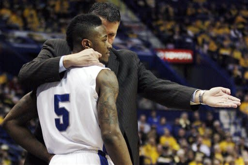 Creighton head coach Greg McDermott talks with Josh Jones (5) in the first half of a Missouri Valley Conference tournament semifinal NCAA college basketball game against Evansville, Saturday, March 3, 2012, in St. Louis. (AP Photo/Tom Gannam)
