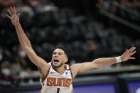 Phoenix Suns guard Devin Booker reacts after he was fouled while driving to the rim in the first half of Game 4 of an NBA second-round playoff series againstt he Denver Nuggets Sunday, June 13, 2021, in Denver. (AP Photo/David Zalubowski)