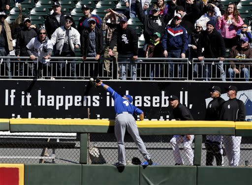 Kansas City Royals left fielder Alex Gordon just misses catching a two-run home run by Chicago White Sox's Dayan Viciedo, also scoring Adam Dunn, during the fourth inning of a baseball game Wednesday, April 3, 2013, in Chicago. (AP Photo/Charles Rex Arbogast)