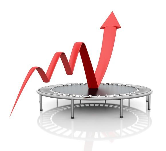 Red charting arrow bouncing off a trampoline.