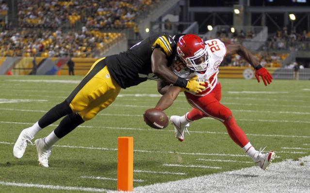 PITTSBURGH, PA - AUGUST 24: Jamaal Charles #25 of the Kansas City Chiefs reaches for the pylon against Lawrence Timmons #94 of the Pittsburgh Steelers in the first half during the game on August 24, 2013 at Heinz Field in Pittsburgh, Pennsylvania. (Photo by Justin K. Aller/Getty Images)