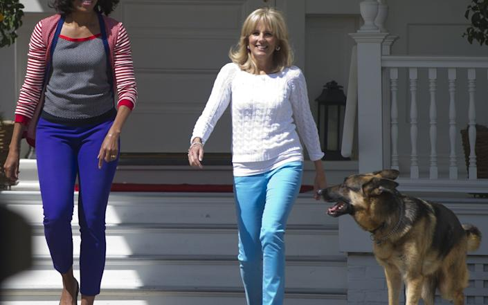 US First Lady Michelle Obama and Jill Biden, wife of US Vice President Joe Biden, and the Bidens' dog Champ - Saul Loeb/AFP