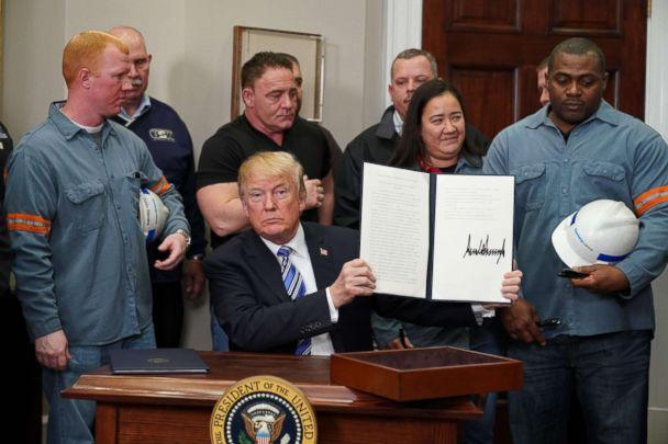 PHOTO: President Donald Trump signs Section 232 Proclamations on Steel and Aluminum Imports in the Oval Office of the White House, March 8, 2018, in Washington. (Mandel Ngan/AFP/Getty Images)