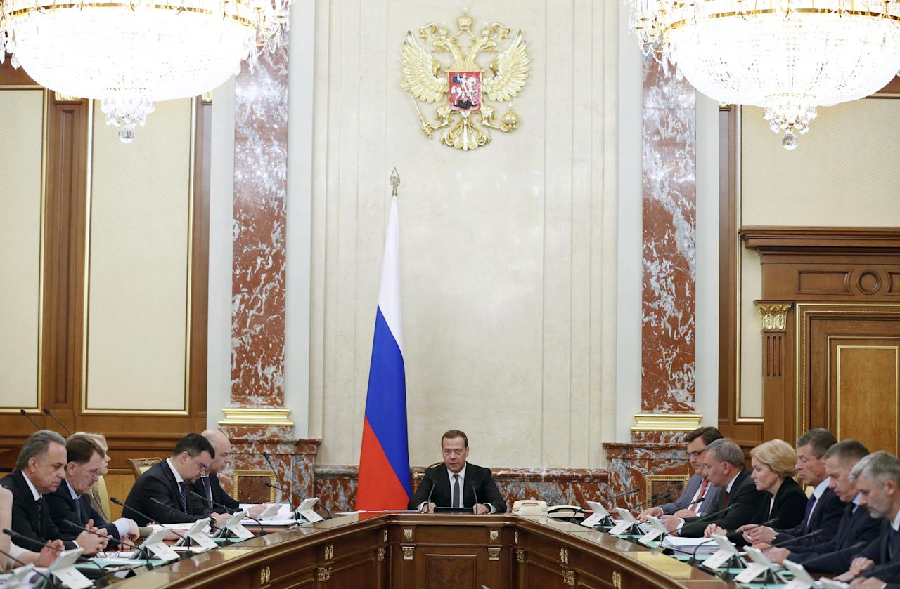 Russian Prime Minister Dmitry Medvedev chairs a meeting of the cabinet on changes in the tax system and in the pension system in Moscow, Russia June 14, 2018. Picture taken June 14, 2018. Sputnik/Dmitry Astakhov/Pool via REUTERS ATTENTION EDITORS - THIS IMAGE WAS PROVIDED BY A THIRD PARTY.