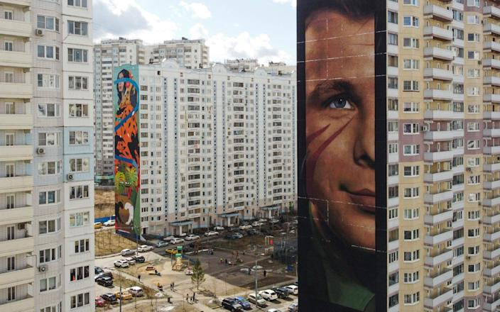 View shows a block of an apartment with a mural depicting Soviet astronaut Yuri Gagarin in Odintsovo-MAXIM SHEMETOV & # xa0; / REUTERS