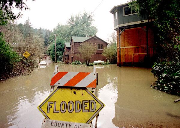 """Flooded homes along the Russian River in California. NOAA scientists and colleagues are installing the first of four permanent """"atmospheric river observatories"""" in California this month, to better monitor and predict the impacts of powerful win"""