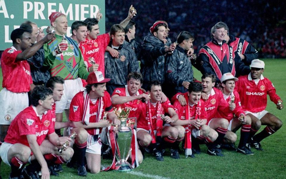 Paul Ince (farthest right) and Manchester United celebrate after winning the 1993 Premier League title.
