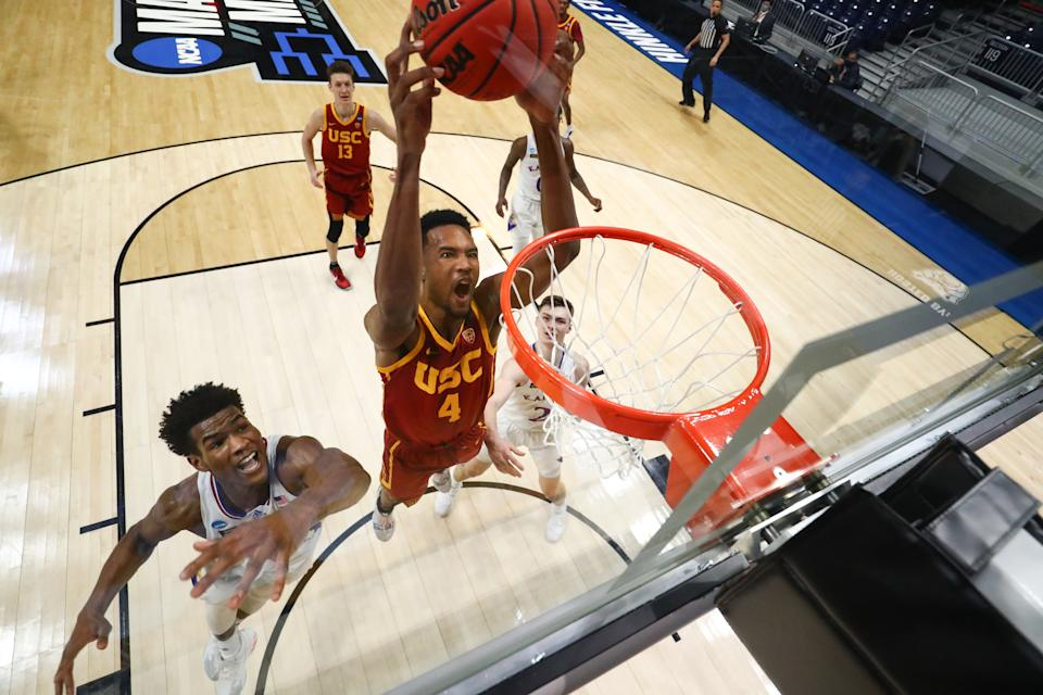 Evan Mobley of the USC Trojans dunks as Ochai Agbaji of the Kansas Jayhawks defends in a second-round NCAA tournament game. (Photo by C. Morgan Engel/NCAA Photos via Getty Images)
