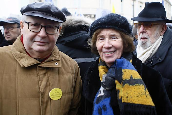Serge Klarsfeld, a French historian, lawyer and Holocaust survivor, left, and his German-born wife Beate Klarsfeld, center, attend a pro-Israel demonstration in front of Israel embassy in Paris, France, Sunday, Jan. 15, 2017. Fearing a new eruption of violence in the Middle East, more than 70 world diplomats gathered in Paris on Sunday to push for renewed peace talks that would lead to a Palestinian state. (AP Photo/Francois Mori)