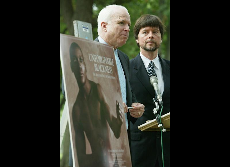 WASHINGTON - JULY 13: U.S. Senator John McCain (R-AZ) (C) speaks as documentary filmmaker Ken Burns (R) looks on during a media conference to discuss a legal petition seeking a posthumous presidential pardon for former boxer Jack Johnson July 13, 2004 in Washington, DC. The petition, which was prepared by the law firm Proskauer Rose, and based on findings from Burns' upcoming film on the life of Jack Johnson, concludes that the 1913 conviction of Johnson for violating the Mann Act was 'discriminatory in intent and conclusion.' (Photo by Alex Wong/Getty Images)