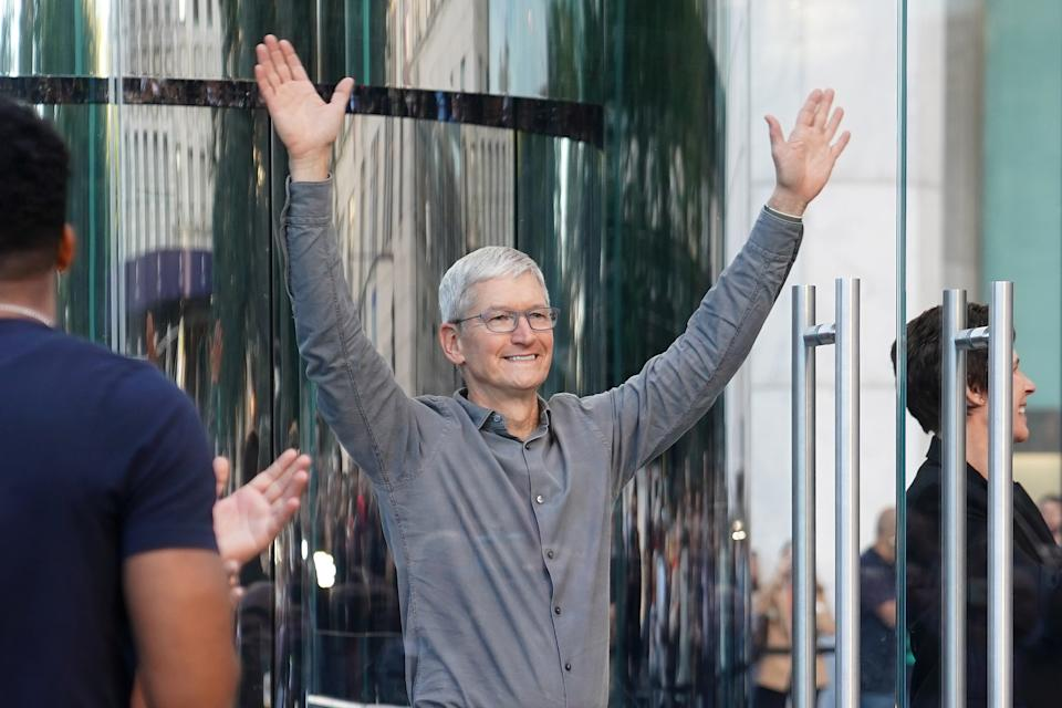 Apple CEO Tim Cook greets fans outside the Apple Store on Fifth Ave in the Manhattan borough of New York, New York, U.S., September 20, 2019. REUTERS/Carlo Allegri