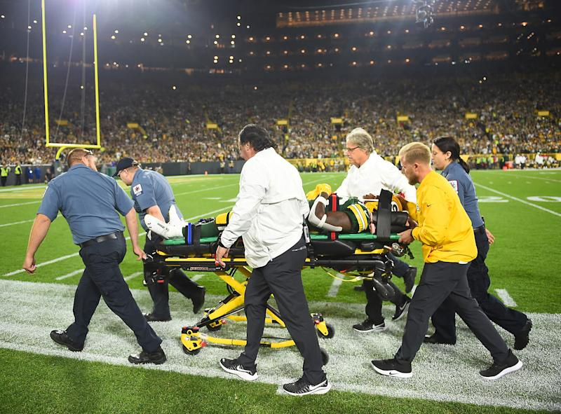 Running back Jamaal Williams of the Green Bay Packers had to be taken out on a stretcher after a helmet-to-helmet from Philadelphia Eagles' DE Derek Barnett on Thursday night. (Getty Images)