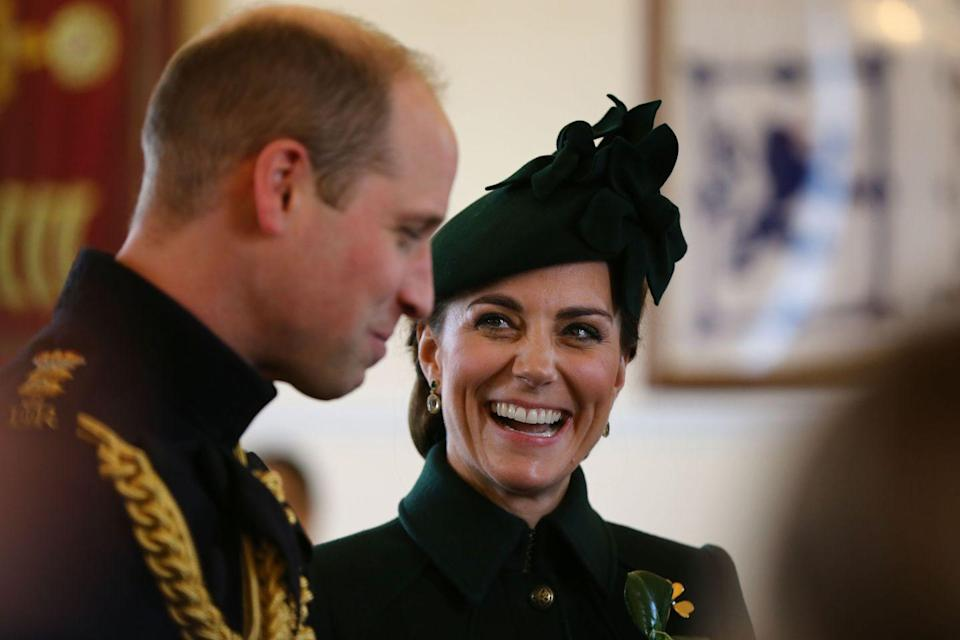 <p>Kate and Will laugh together during their visit to the St. Patrick's Day Parade in Hounslow, England. </p>