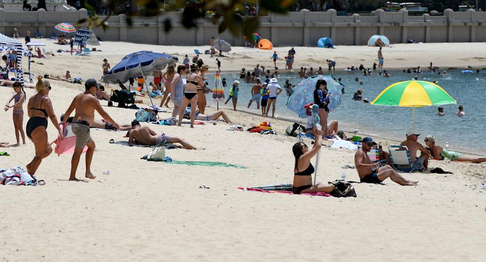 Sydney's Balmoral Beach crowded with people.