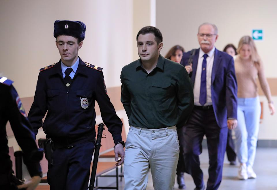 U.S. ex-Marine Trevor Reed, who was detained in 2019 and accused of assaulting police officers, is escorted before a court hearing in Moscow, Russia March 11, 2020. (Tatyana Makeyeva/Reuters)