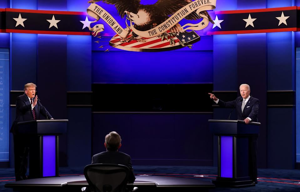 U.S. President Donald Trump and Democratic presidential nominee Joe Biden participate in their first 2020 presidential campaign debate held on the campus of the Cleveland Clinic at Case Western Reserve University in Cleveland, Ohio, U.S., September 29, 2020. REUTERS/Jonathan Ernst     TPX IMAGES OF THE DAY