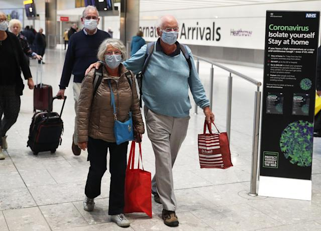 Passengers of the coronavirus-stricken Braemar cruise ship are pictured returning to Heathrow Airport in London. (Getty Images)