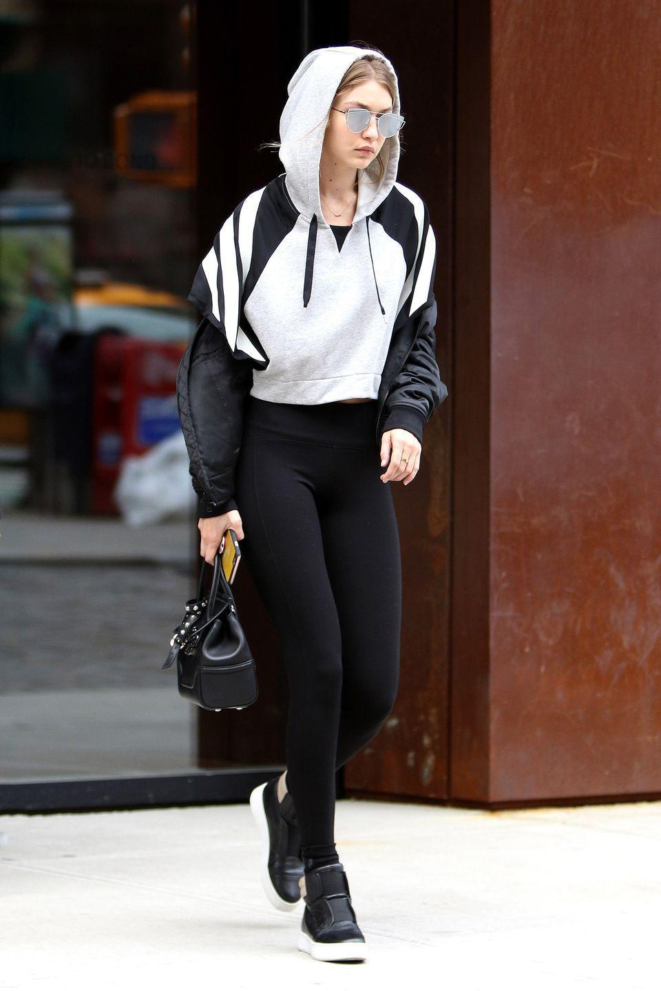 <p>Gigi Hadid stepping out of her apartment in Opening Ceremony leggings, a cropped sweatshirt, and Gentle Monster sunglasses. </p>