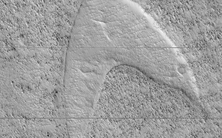 These curious chevron shapes in southeast Hellas Planitia are the result of a complex story of dunes, lava, and wind.