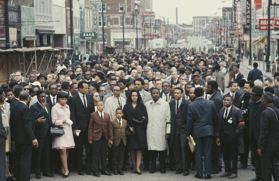 Crowds surrounding Dr. Martin Luther King Jr. (Getty Images)