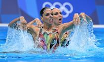 <p>Italy's Linda Cerruti and Italy's Costanza Ferro compete in the preliminary for the women's duet free artistic swimming event during the Tokyo 2020 Olympic Games at the Tokyo Aquatics Centre in Tokyo on August 2, 2021. (Photo by Attila KISBENEDEK / AFP) (Photo by ATTILA KISBENEDEK/AFP via Getty Images)</p>